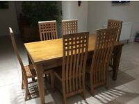 Solid oak dining table and teak chairs