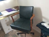 Retro Swivel chair. 1970's. Age related wear and tear. Dark green seat.