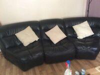 Black leather Italian corner sofa with chaise long