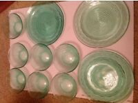 Green tinted glass serving bowls and platters