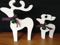 christmas star gazing reindeer decorations mother and baby white green bells blue red tartan ribbon