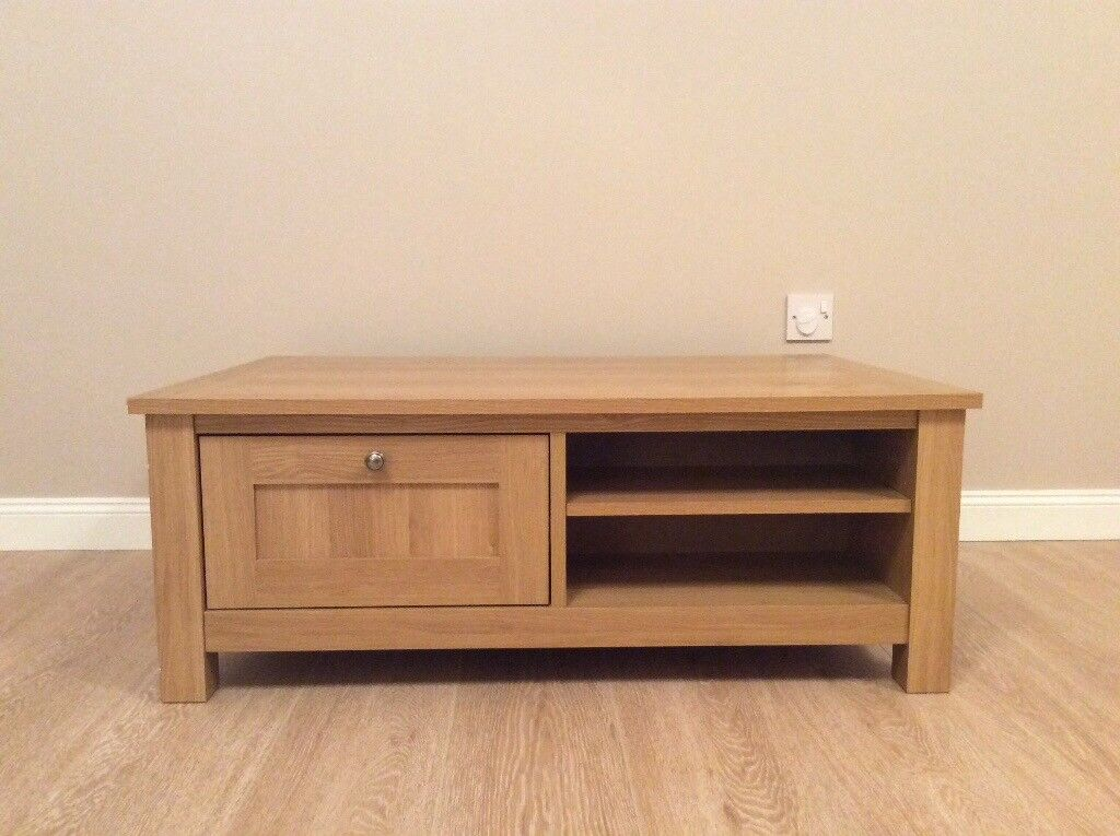 wooden coffee table with one storage drawer and two shelves very