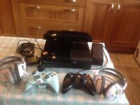 X Box 360 with Kinekt two rechargeable controllers and headphones plus a few games.