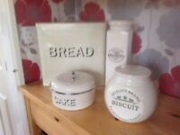 Set of kitchen accessories, bread bin and cake tin are metal the others are crock