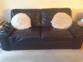 Black leather sofas, good condition.