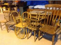 Collection of various old wooden chairs, including Ercol.