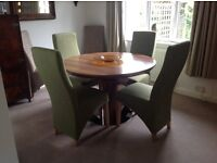 Contemporary round extending dining table