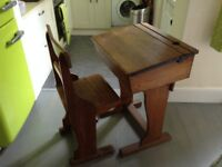 Very old oak school desk and chair. Desk has lift top and inkwell.