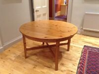 IKEA antique pine effect extending dining table.