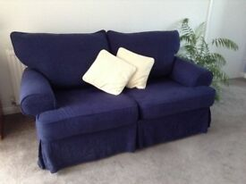 2 Two seater fabric sofas with removable covers, including an extra set.
