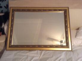 gold guilt framed bevel edged mirror
