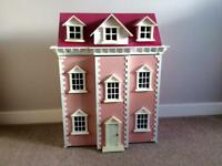 Three storey pink dolls house in excellent condition
