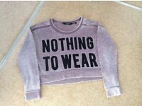 "Girls purple ""nothing to wear"" sweatshirt age 9 from new look"