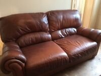 Leather sofa chair and pouffee