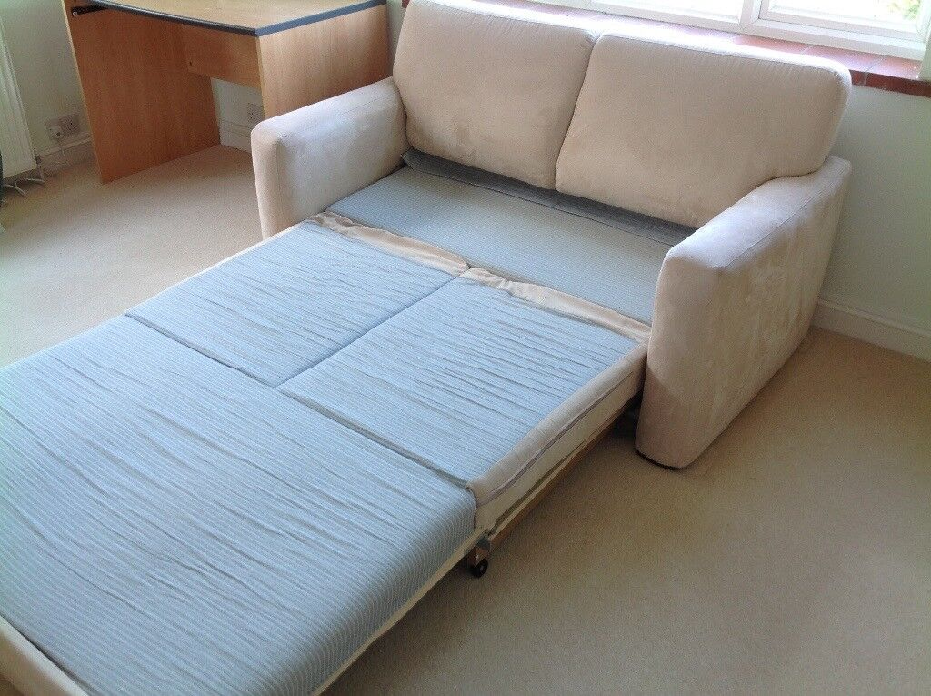 John Lewis double sofa bed in cream in good condition.