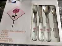 New 24 piece cutlery set with rose design on the handles