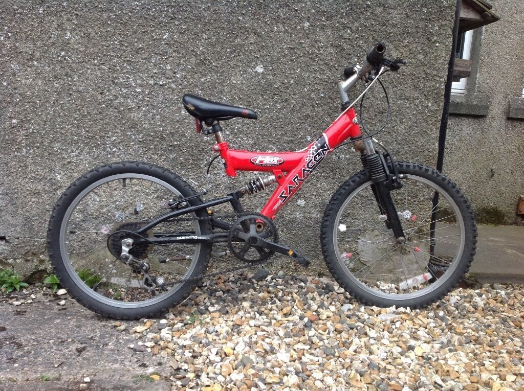 For sale a well used Saracen Hex full suspension child\'s bike with ...