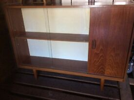 Wooden cabinet with sliding glass doors