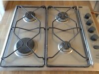 Stainless steel gas hob with electric ignition.