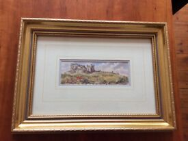Framed water colour print of Bamburgh Castle