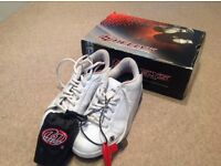 Heely's white trainers