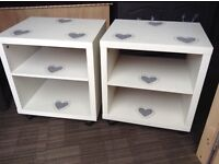 Matching pair of bedside tables with open backs and grey shabby chic heart detail