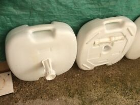 1 white plastic parasol weights £10 , already heavy and filled with sand, never used in the end