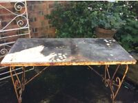 Old metal and stone table, plus metal railings