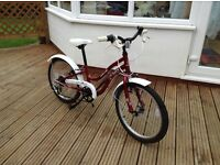 Girls bicycle. Dark red frame. Complete with stand.