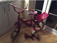 Pink girl's bike for sale with stabilisers. Pink Hello Kitty helmet also included.