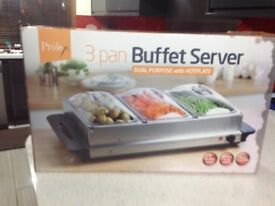 Electric Buffet Server for keeping food hot with 3 sections.