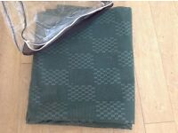 Breathable caravan awning or tent ground sheet