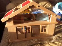 Wooden Chalet style Dolls House complete with all furniture and family figures. Excellent condition.