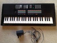Yamaha PortaSound PSS-470 Stereo Digital Synthesizer Piano Keyboard with Adapter