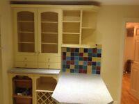 Kitchen units and breakfast bar.