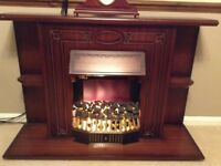 Electric fire with a wooden surround