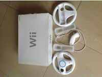 Nintendo Wii - with 2 games and 2 cart wheels.