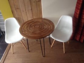 Hinder table hair pin legs and eamnes chairs