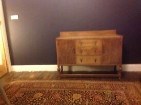 30's style sideboard in brown wood. 3 drawers and two. Cupboards.