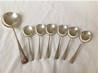 Set of six silver plated soup spoons and one serving spoon.