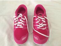 Brand new small fit Nike trainers size 5