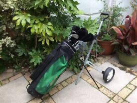 Full set of 20 golf clubs (some spare) complete with quality Dunlop bag, Stand and Trolley, +Balls.