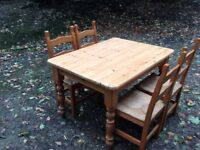 Pine farmhouse table and four 4 chairs country. Dining set.