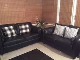 2 x 2 seater black leather sofas, good condition, selling as a pair.