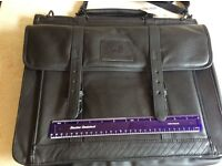 New leather black briefcase with tag