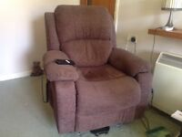 Dark brown fabric electric powered armchair. Rise and recline. Full working order