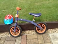 Kiddies balance bike in well used condition,plus safety helmut