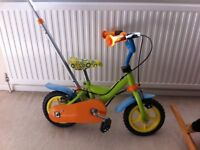 Kids first bicycle with stabilizer and push along