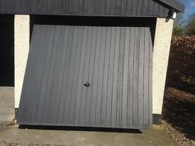 Garage doors up and over plus electric openers, cedar clad excellent condition