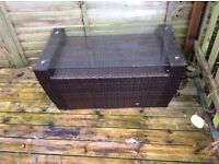 Faux rattan low table or bench if glass is moved. Can be left outside all year.